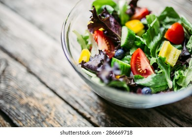 Healthy mixed greens and colorful veggies salad with blueberries