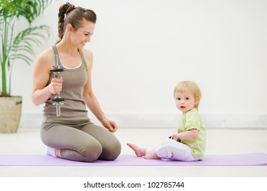 Healthy mother and baby spending time doing fitness