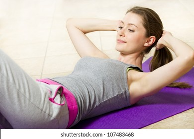 Healthy and motivated woman exercising and getting fit
