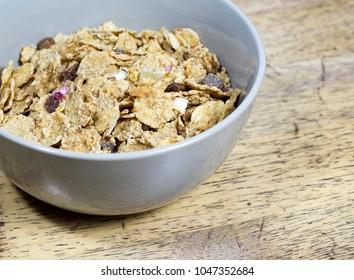healthy muesli on a wood background
