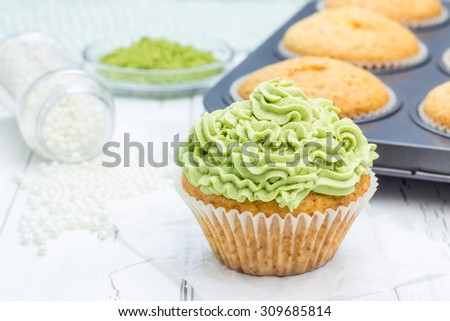 Healthy muffins with ricotta cheese and matcha frosting