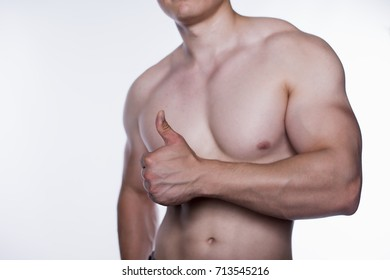 Healthy muscular young man with nude torso. Isolated on white background.