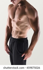 Healthy muscular young man posing.  Sport portrait. Detail.
