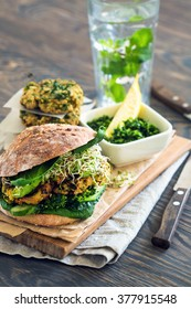 Healthy natural meal: Vegan sourdough burger with sprouted greens and chickpea rissole