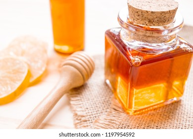 Healthy nature and nourishment vitamin with honey bee and lemonade on wooden desk.