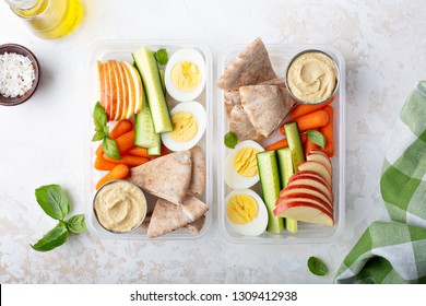 Healthy and nutricious lunch or snack boxes to go with hummus and pita, eggs and vegetables