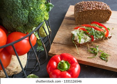 Healthy nutrition concept with fresh vegetables and whole grain bread for a diet