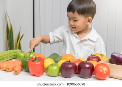 Healthy and nutrition concept. Kid learning about nutrition how to choose eating fresh fruits and vegetables.