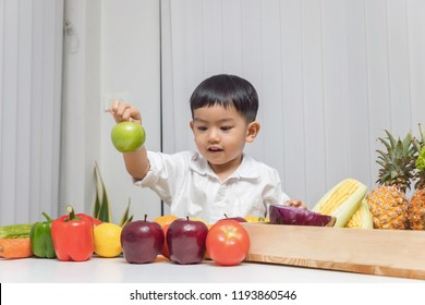 Healthy and nutrition concept. Kid learning about nutrition to choose how to eat fresh fruits and vegetables.