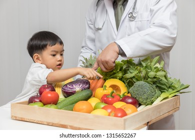 Healthy and nutrition concept. Kid learning about nutrition with doctor to choose eating fresh fruits and vegetables.