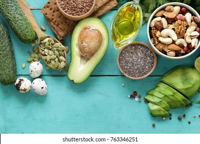 healthy and nutrition food - avocado, chia and flax seeds, olive oil and vegetables