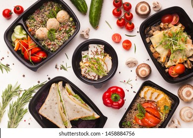 Healthy nutrition. Good quality food in take away boxes with fresh vegetables on white background