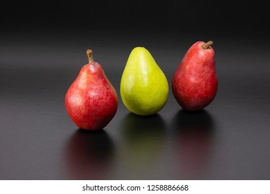 Healthy and nutritious snacks.  Delicious fresh pears on a black background with text space.  D'Anjou and Starkrimson Red Pears variety.