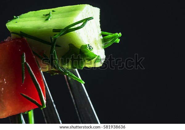 Healthy, nutritious vegetables on a fork, close-up. Focus on vegetables