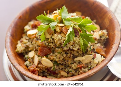 Healthy nutty Quinoa and Bacon Salad with toasted sliced almonds and parsley