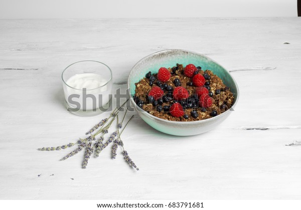 Healthy oat and almond flour berry crumble with soja yogurt