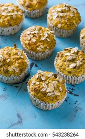 Healthy oat diet muffins on a blue background