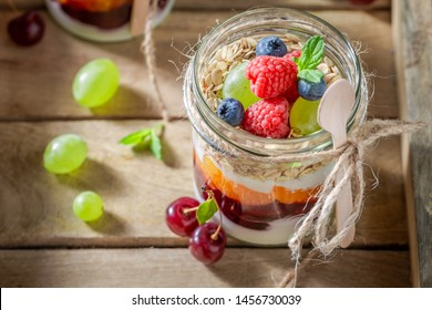 Healthy oat flakes with fresh berries and yoghurt in jar