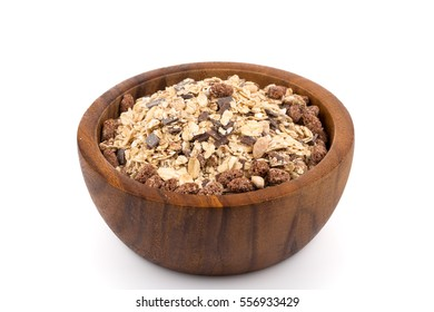 Healthy oat granola muesli cereals with chocolate in a bowl on white