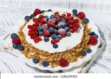 healthy oatmeal cake with yogurt and fresh berries, top view