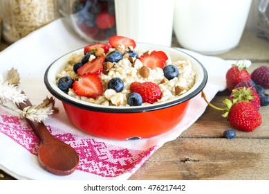 Healthy oatmeal porridge with berries and nuts for breakfast
