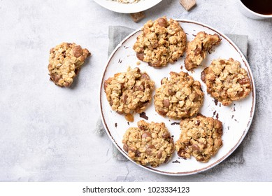 Healthy oats cookies on plate over stone background. Top view, flat lay
