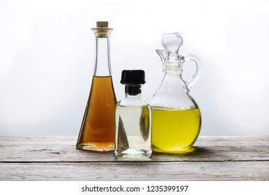 Healthy oils in glass bottles, olive, sunflower, walnut oil.
