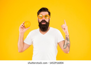 Healthy orange recipe idea. Hipster with genius idea pointing finger up on yellow background. Bearded man got bright idea for natural dieting. Super food idea.