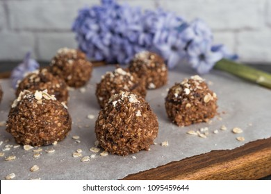Healthy organic energy granola balls with oat flakes, peanuts, dates, cacao, banana, chocolate and honey - vegan vegetarian raw snack or meal