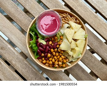 Healthy Organic Food Bowl with Roasted Chickpea, Pineapple, Fusilli Pasta and Cherry Sauce. Take Away