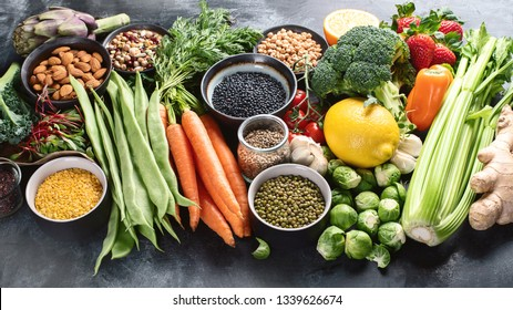 Healthy organic food on dark background.  Vegan and vegetarian diet food concept. Clean eating. Top view with copy space