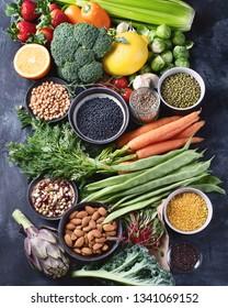 Healthy organic food on dark background.  Vegan and vegetarian diet food concept. Clean eating. Top view, flat lay