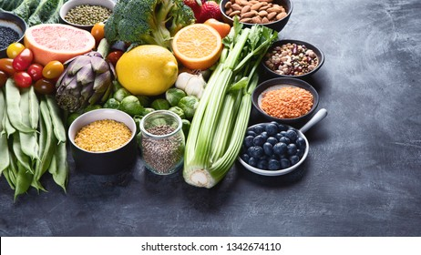 Healthy organic food on dark background.  Vegan and vegetarian diet food concept. Clean eating. Image with copy space