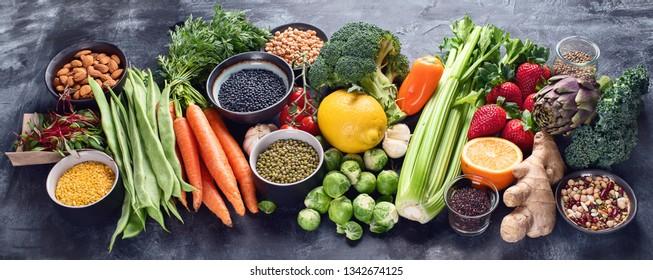 Healthy organic food on dark background.  Vegan and vegetarian diet food concept. Clean eating. Top view. Paniorama, banner