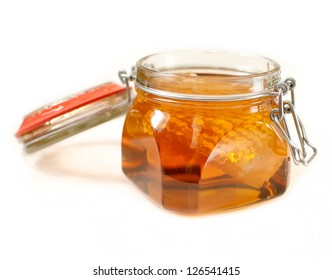 healthy organic honey in a jar isolated on white background