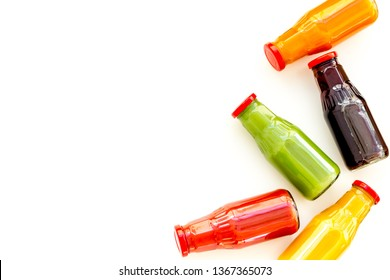 healthy organic juice in bottles for fitness diet and detox on white background top view mockup