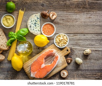 Healthy organic nutritious diet. Plenty of foods on the wooden table.