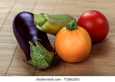 Healthy organic vegetarian diet raw food. Fresh yield of gourd, squash tomato and black eggplant