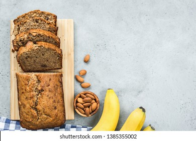Healthy paleo almond banana bread loaf on grey concrete background. Table top view