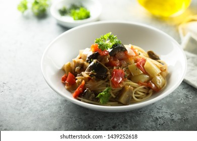 Healthy pasta with vegetable sauce and fresh parsley