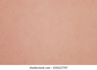 Healthy pattern of young skin. Texture of human skin with cells