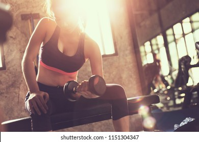 healthy people workout and building body at gymวfitness man building muscle and weight training with dumbbell at gym