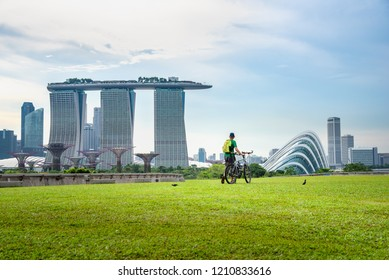 Healthy peple driving fitness bike exercise in the morning at Singapore public park, Singapore.