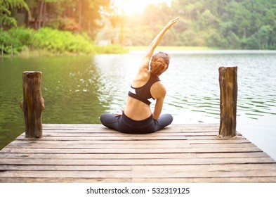 Healthy person woman lifestyle balanced body practicing meditate and energy fit yoga relax and spirit on the bridge in morning the nature.  Healthy Concept