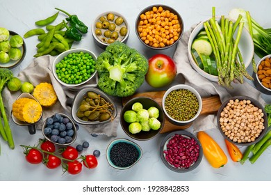 Healthy plant based food, best protein source on light grey background. Vegan, clean eating concept. Top view
