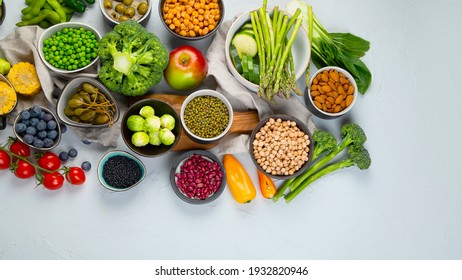 Healthy plant based food, best protein source on light grey background. Vegan, clean eating concept. Top view, copy space