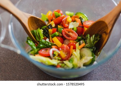 healthy plant-based recipes, salad bowl with greens tomatoes capsicums and mixed veggies