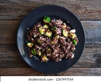 Healthy plate: red quinoa with zucchini and tuna, complete dish with all macronutrients