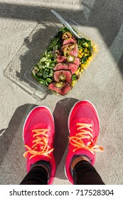Healthy prepared food for Gym meal prep paleo diet fitness lifestyle. Woman taking top view selfie photo of her takeaway steak salad lunch box at home for training bodybuilders crossfit lifestyle.