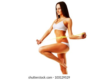 Healthy pretty woman with yellow measure on white background